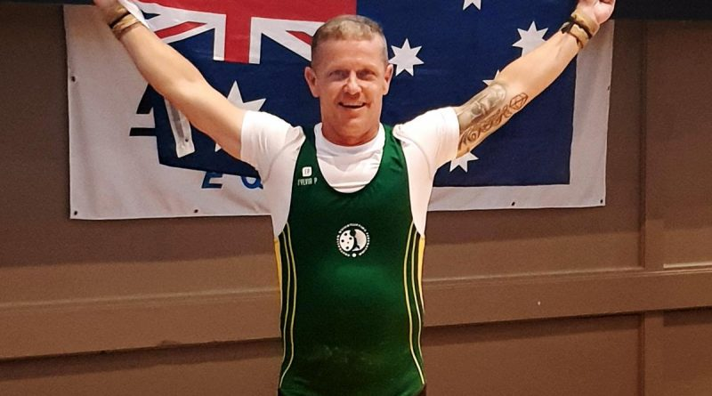 Champion weightlifter Sergeant Steven Graham celebrates his best result. Story by Corporal Veronica O'Hara.
