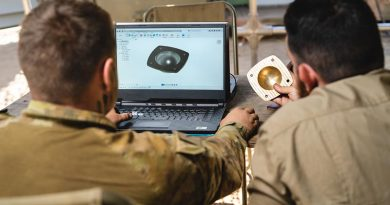 Specialist soldiers use a WarpSPEE3D Tactical printer to make a wheel-bearing hub for an M-113 APC at Bradshaw Field Training Area, NT, during Exercise Koolendong. Photo supplied.