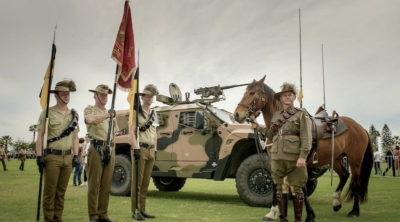 Members of the 10th Light Horse Regiment and the 10th Light Horse Memorial Troop stand in front of the regiments modern steed. Photo by Sergeant Gary Dixon.