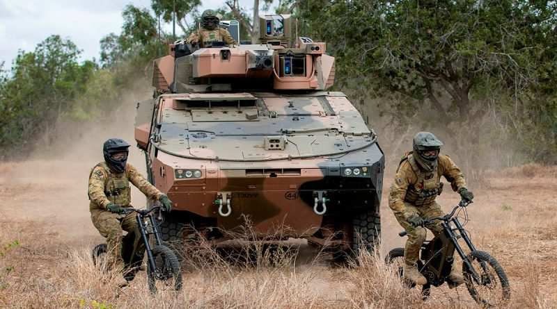(left) Trooper Damian Day and Corporal Thomas Ovey from the 2nd/14th Light Horse Regiment (Queensland Mounted Infantry) conduct a scouting patrol on Australian Army Stealth Reconnaissance E-Bikes at Townsville Field Training Area, Queensland. Story by Captain Taylor Lynch. Photo by Corporal Nicole Dorrett.