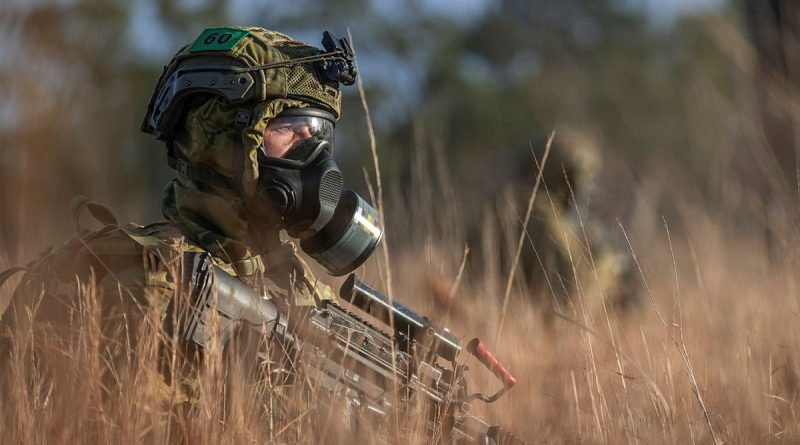 A soldier from the 6th Battalion, Royal Australian Regiment, patrolling during a simulated chemical, biological, radiological, nuclear survival training exercise at Townsville Field Training Area, Queensland. Story by Captain Taylor Lynch. Photo by Corporal Nicole Dorrett.