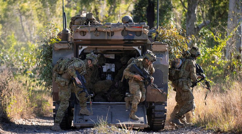 Sappers from the 2nd Combat Engineer Regiment dismount an Australian Army M113AS4 Armoured Personnel Carrier to conduct a simulated breach of an enemy position while training at Townsville Field Training Area, Queensland. Photo by Corporal Nicole Dorrett.