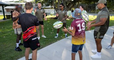 Players from the Wallabies Rugby team throw footballs with participants of the Proud Warrior Youth Engagement Program at Pallarenda Beach, Queensland on 23 September 2021. Story by Captain Lily Charles. Photo by Corporal Brandon Grey.