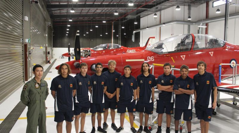 Qualified flying instructor with No. 2 Flying Training School Flight Lieutenant Jonathan Lee and students from Clontarf Academy in front of a Pilatus PC-21 aircraft at RAAF Base Pearce. Story by Flight Lieutenant Steven Barrett.