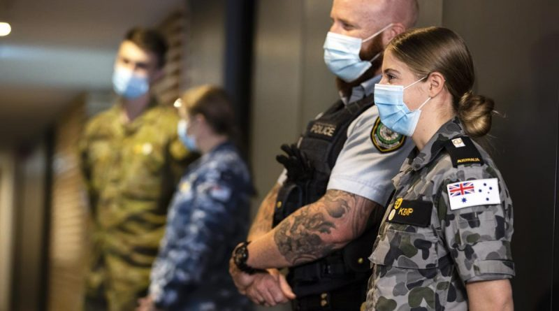 NSW Police Senior Constable Peter Heginbotham, front left, and Midshipman Bridie Kemp on hotel quarantine duties during Operation COVID-19 Assist. Story by Flight Lieutenant Eamon Hamilton. Photo by Corporal Dustin Anderson.