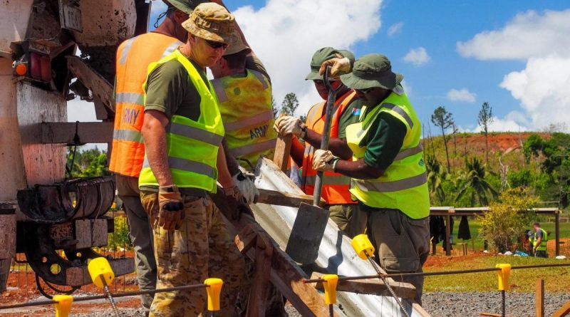 Captain Thomas Sefton, front, and other members of the ADF construction engineer team place concrete into the footings of a new classroom building at Lekutu Secondary School in Fiji. Story by Captain Michael Trainor.