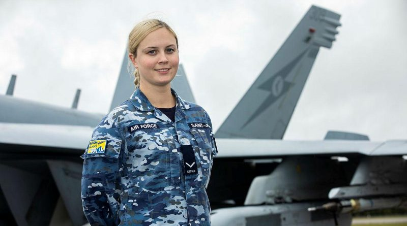 Leading Aircraftwoman Alexandra Saint-John, of No. 6 Squadron, with an EA-18G Growler aircraft on the flightline at Eielson Air Force Base in Alaska. Story by Flying Officer Bronwyn Marchant. Photo by Sergeant Rodney Welch.