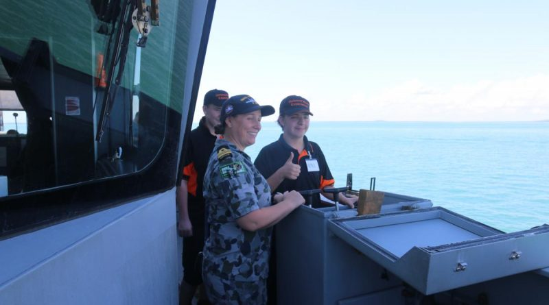 Commanding Officer HMAS Maitland Lieutenant Commander Julia Griffin shows Kyle Firgula-White and Alex Ryan how to drive the ship. Story by Lieutenant Liam Feenan.