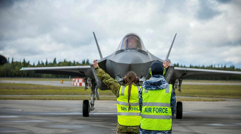 Leading Aircraftman Paul Taylor supervises Aircraftwoman Milena Frolova from No. 3 Security Forces while marshalling an F-35A Lightning II from No. 3 Squadron at Eielson Air Force Base in Alaska, United States. Story and photo by Flying Officer Bronwyn Marchant.