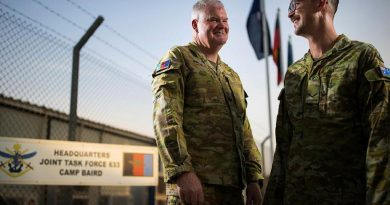 Major Brett Pates, left, and his son, Lance Corporal Timothy Pates, are both deployed to the Middle East region on Operation Accordion. Story by Flight Lieutenant Clarice Hurren. Photo by Sergeant Glen McCarthy.