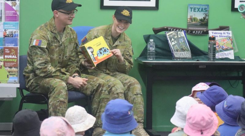 Lieutenant Thomas McAllister and Private Nikita Booth read a story to some children at the library in Texas, Queensland. Story by Captain Pete Conrad.