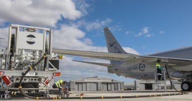 Leading Aircraftman Peyman Zeinali, left, and Leading Aircraftman Nicolas Ballingal use RAAF Base Edinburgh's in-ground refuelling system for the first time with an Air Force P-8A Poseidon. Story by Corporal Abbey Leonard. Photo by Corporal Brenton Kwaterski.