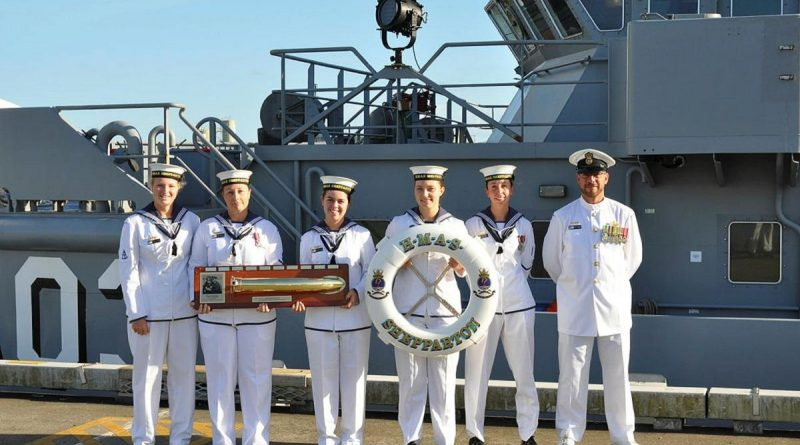 HMAS Shepparton's Hydrographic Department proudly displays the First Lady of the Fleet plaque at HMAS Cairns. Story by Able Seaman Emily Wain and Able Seaman Rebecca Churches.