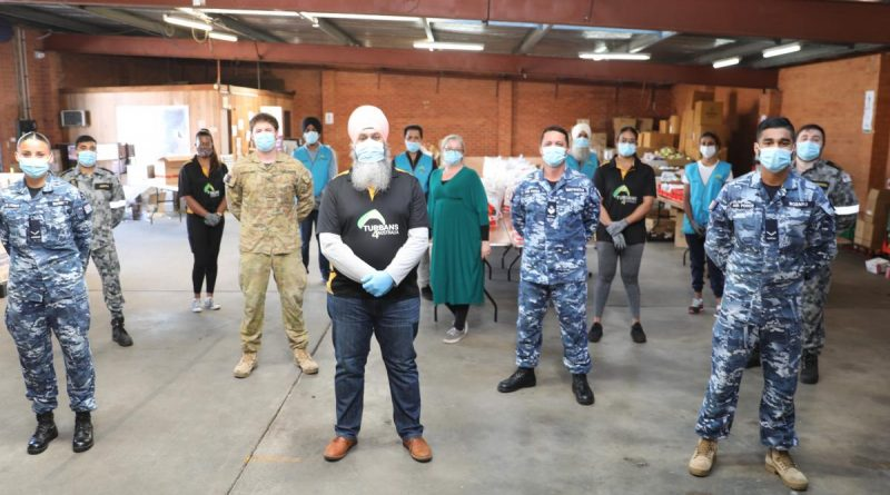 Turbans 4 Australia President Amar Singh with ADF members at the charity's warehouse in Clyde, NSW. Story by Lieutenant Brendan Trembath.