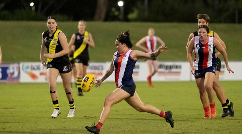 Corporal Rhian Mears, of 3rd Brigade Headquarters, plays for the Curra Swans Australian Rules football team during their grand final win in Townsville. Story by Captain Diana Jennings. Photo by Corporal Brodie Cross.