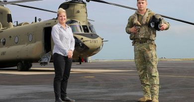 Townsville Defence Weather Service Office manager Krystelle Venn with 5th Aviation Regiment's Lieutenant David Selvage at RAAF Base Garbutt, Queensland. Photo by Lance Corporal Lisa Sherman.